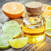 picture of essential oil  - Citrus essential oil and slice of ripe fruits - JPG