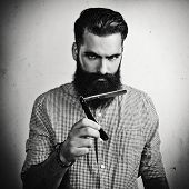 B/w Portrait Of A Handsome Bearded Man With Straight Razor