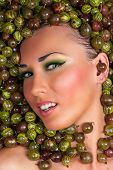 sexy beautiful female face in the gooseberry