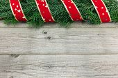 Christmas Background With Fir Tree And Ribbon On Wood