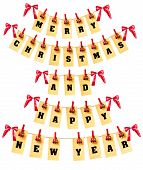 stock photo of pegging  - Merry Christmas and Happy New Year lettering with clothes - JPG
