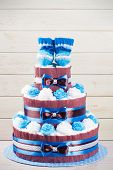 foto of diaper  - cake made from diapers standing on wooden table - JPG