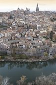 Picture of toledo view at sunset with cathedral and tajo river.