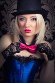 picture of cabaret  - beautiful cabaret woman showing pink bow - JPG
