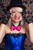 pic of cabaret  - beautiful cabaret woman posing against retro wallpapers - JPG