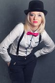 stock photo of bow tie hair  - beautiful young woman wearing tophat bow - JPG