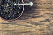 foto of darjeeling  - Dry tea in wooden plate on wooden table - JPG