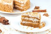 foto of walnut  - Slice of baked easter carrot cake with raisins and walnut on white background - JPG