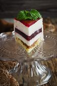 foto of cream puff  - piece of cake with a cream puff on a glass base on the old wooden background - JPG