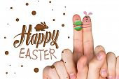 stock photo of easter bunnies  - Fingers as easter bunny against happy easter graphic - JPG