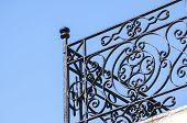 stock photo of wrought iron  - Corner of black painted wrought - JPG