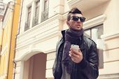 picture of snickers  - Guy in sunglasses and earphones on the street - JPG