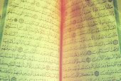 image of quran  - in side quran with light ray background - JPG