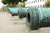 image of cannon  - Antique ornamented cannon barrels standing in row - JPG