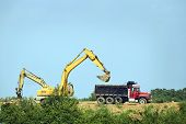 image of truck-cabin  - Horizontal shot of an excavator loading a dump truck - JPG