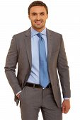 stock photo of mans-best-friend  - Confident, friendly businessman looking to the camera. Man in shirt with tie. Isolated on white background ** Note: Soft Focus at 100%, best at smaller sizes - JPG