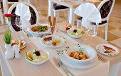 stock photo of catering  - Detail of table set for wedding or another catered event dinner - JPG