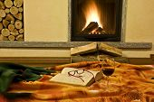 Постер, плакат: The fireplace and the book