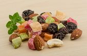 foto of mixed nut  - Fresh Nuts and dry fruits mix heap - JPG