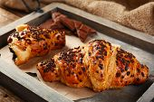 stock photo of sackcloth  - Fresh and tasty croissants with chocolate on wooden tray - JPG