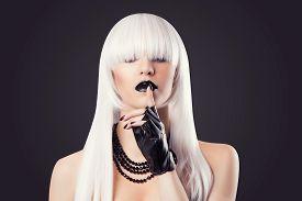stock photo of hush  - beautiful blonde woman with black make - JPG
