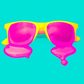 pic of nerd glasses  - Exclusive yellow hipster sunglasses on blue background. dripping pink paint. explosion summer colors