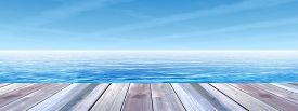 stock photo of wood  - Concept or conceptual old wood or wooden deck on coast of exotic blue clear sea or ocean waves and sky vacation or tourism background banner - JPG
