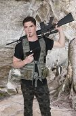 pic of rifle  - Handsome young man soldier with a pistol and rifle smoking - JPG