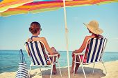 stock photo of sunbathing woman  - summer vacation - JPG