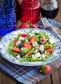 picture of pine nut  - Fresh delicious arugula strawberry blueberry pine nuts and blue cheese salad - JPG