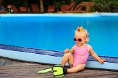 stock photo of flipper  - cute girl with flippers in swimming pool at tropical beach - JPG