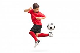 pic of balls  - Studio shot of a junior soccer player performing a trick with a soccer ball isolated on white background - JPG