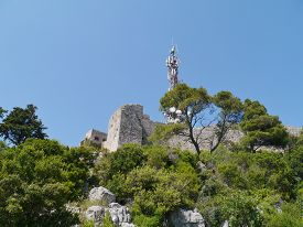 pic of antenna  - A communication tower on the top of the mountain above Preko on the island Ugljan in Croatia - JPG