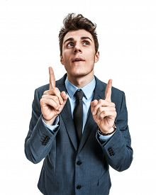 image of queer  - Portrait young man has an idea pointing with fingers up  - JPG