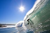 Surfer in Perfect Tube with Sun