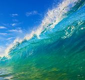 Crystal Clear Aqua Blue Wave Breaks in Ocean