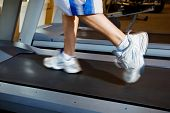 Close Up of Man Running on Treadmill