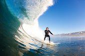 Surfer on Large Blue Wave