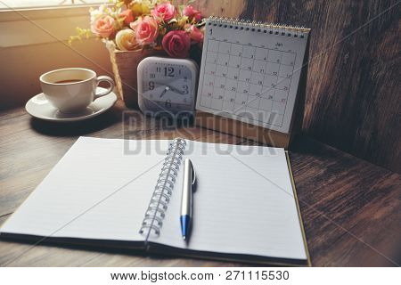 poster of Desktop Calendar 2019 ,cup Of Coffee Place On Office Desk.calender And Notebook For Planner, Timetab