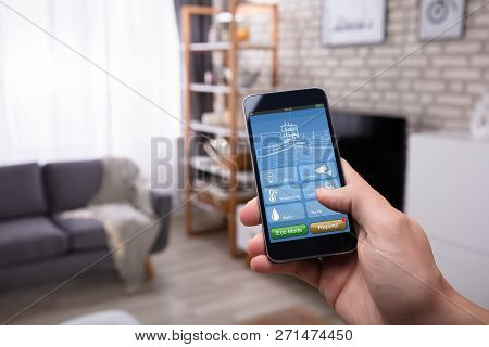 poster of Man Using Smart Home Application On Mobile Phone