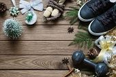 Fitness And Healthy Christmas Sport Composition. Flat Lay Of Sport Shoes, Dumbbells, Skipping Rope A poster