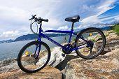 bike in the sea bay and blue sky