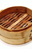 Chinese steamed dimsum in bamboo containers traditional cuisine