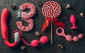 Various Sex Toys Anal Balls, Vibrator, Fur Handcuffs And Others, Christmas Balls And Candy. poster