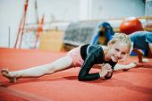 Young gymnast stretching her body poster