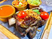 Delicious Plate Of Ribs, Guacamole, Salad, Sauces And Tomatos poster