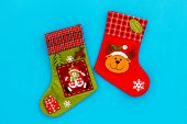 Christmas Socks. Traditional Decorative Socks For Small Gifts On Blue Background Top View poster