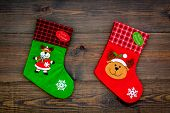 Christmas Socks. Traditional Decorative Socks For Small Gifts On Dark Wooden Background Top View poster