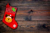 Decorative Christmas Socks. Empty Socks For Gift Hanging Off A Thread On Dark Wooden Background Top  poster