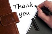 stock photo of thank you note  - Thank you write by male hand - JPG
